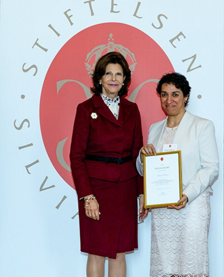 Graduation ceremony for Silvia Physicians. Niran el Kuoni receives her diploma from H M Queen Silvia Bernadotte.