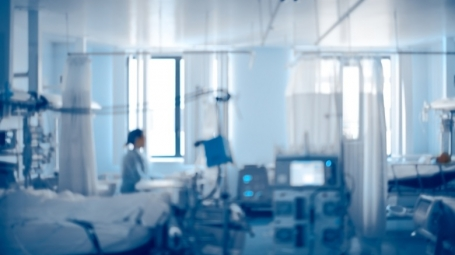 Equipped intensive care unit of modern hospital, unfocused background.