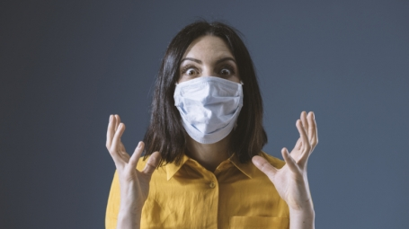 Worried woman with face mask.