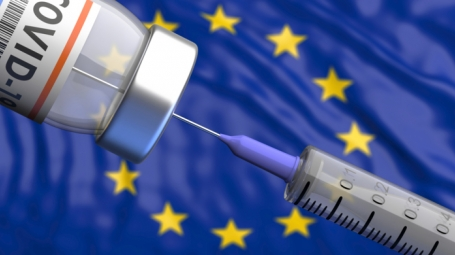 Vaccine syringe with EU-flag in background