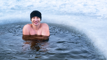 Smiling man who is ice bathing