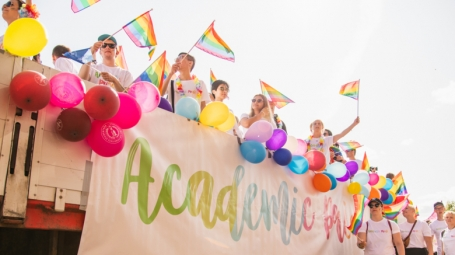 Colorful images of happy people, pride flags and a sunny sky.