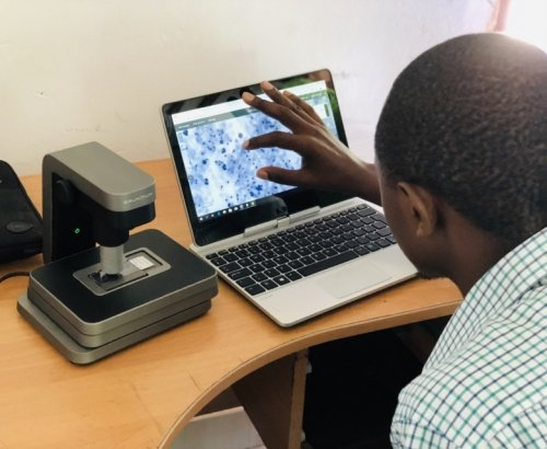Martin Muinde scanning pap smears at the Kinondo clinic in Kenya.