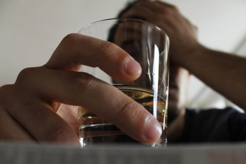 Photo of man with drinking glass.